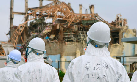 Members of the Japanese government investigate the accident at Fukushima nuclear